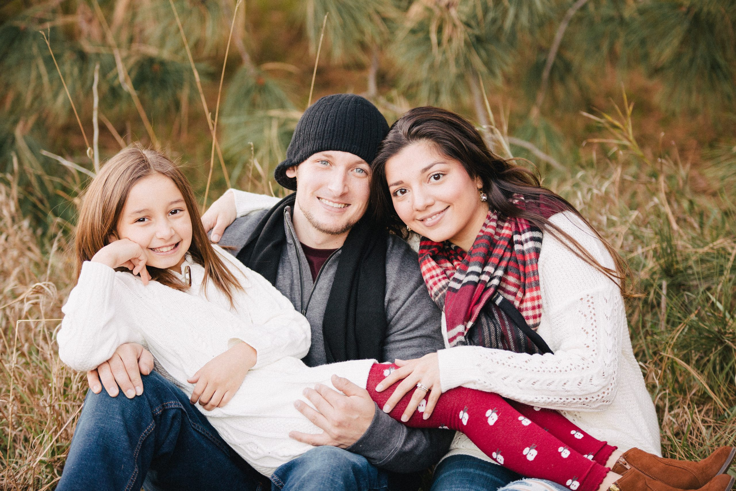 A family of three in Omaha, Nebraska pose for a portrait from Jerred Z Photography.