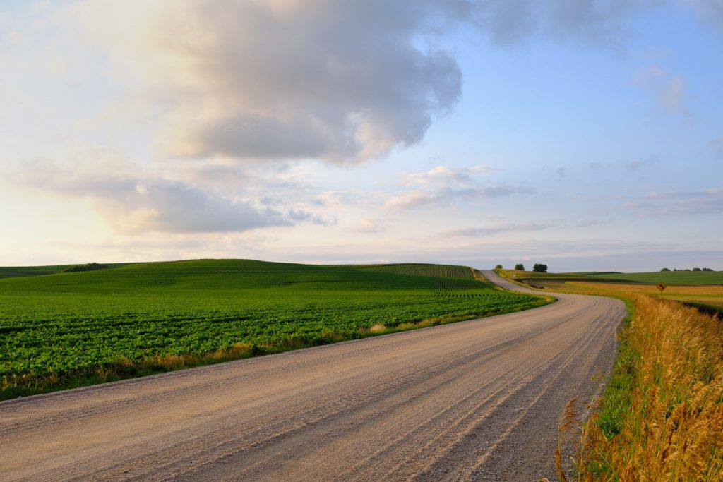 A beautiful winding road and hill in Nebraska as the evening fades. Shot with an Fuji X-E4 and XF 27mm f/2.8.